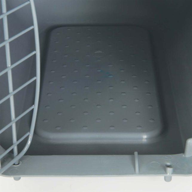 Fond de cage antidérapant avec gouttière de ramassage en cas de dégât d'urine ou de déversement de nourriture